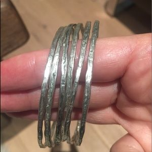 Six included Stunning Textures Silver Bangles